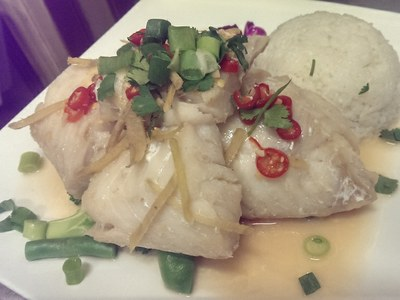 Rock Ling fillet steamed with lemon, fresh ginger, soy sauce  and served with creamy coconut rice.