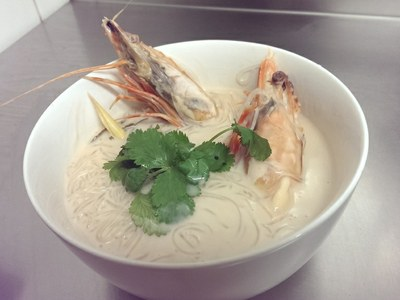 Tiger prawns in a mild and creamy coconut soup with glass noodles.